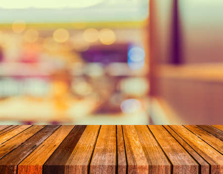 back alley: image of selective focus on surface of wood table and blur japanese restaurant for background usag
