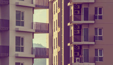 urban idyll: vintage tone image of Modern Luxury apartments (condo) on day time for background usage. Stock Photo
