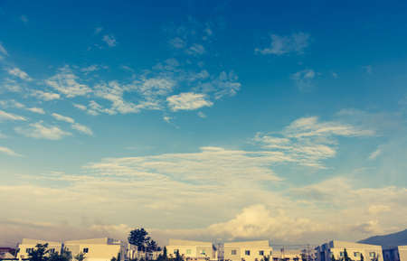 residential idyll: apartments (condo) and beautiful blue sky . Stock Photo