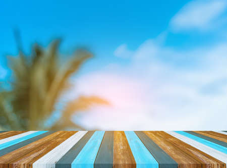image of wood table and blur coconut tree for background usage.