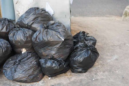 dumpster: image of black garbage bag on the street. Stock Photo