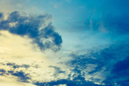 vintage tone image of blue sky and white clouds on day time for background usage.(horizontal) Stock Photo
