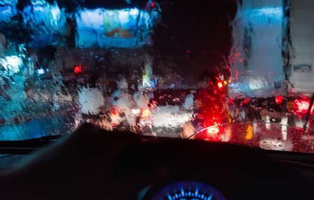 winter road: image of people driving car on night time for background usage.(take photo from inside focus on front car windshield) Stock Photo