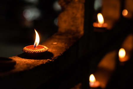 image of tradition Thai styel candle in clay pot during Loy Krathong festival in Chiang Mai , Thailand.