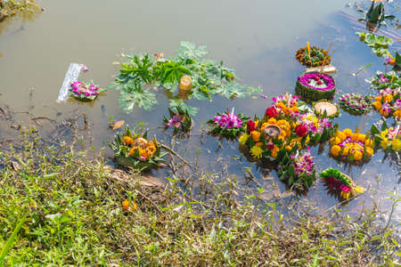image of organic waste in ping river from Loi Krathong festival (a small container made of leaves which can be floated on water)