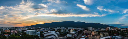 panorama image of sky above modern Chiang Mai city and doi Suthep mountain on evening time view from high angle spot.