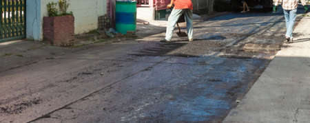 image of  asphalt road fixing on day time. Stock Photo
