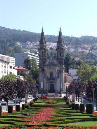 touristy: Park leading to a church in Guimaraes, Portugal.                                Stock Photo