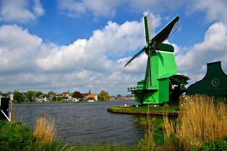 Picture of dutch windmill with nice green grass in front of them Stock Photo - 3075472