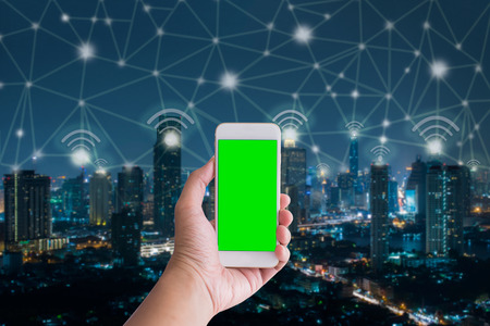 handholding: Handholding smartphone with city and connection line,network and technology concept