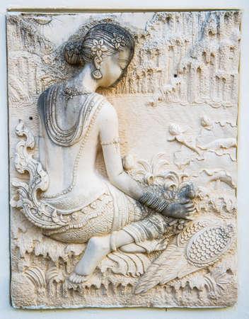 Thai Statues of ancient women sit