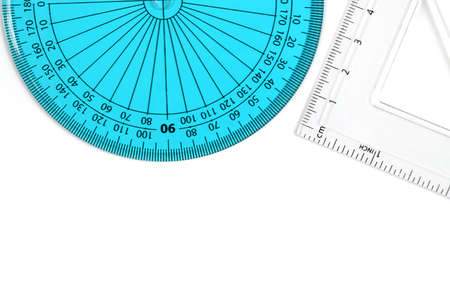 construction draftsman: Geometry items for schooldesign. Blue protractor and clear set square against white background. Copy space. Stock Photo