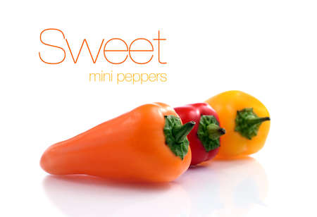 bell peppers: Studio macro of three sweet mini-peppers against a white background  Copy space  Stock Photo