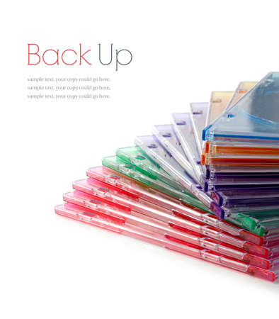 Colourful stacked plastic DVD cases on a white surface. Copy space. photo