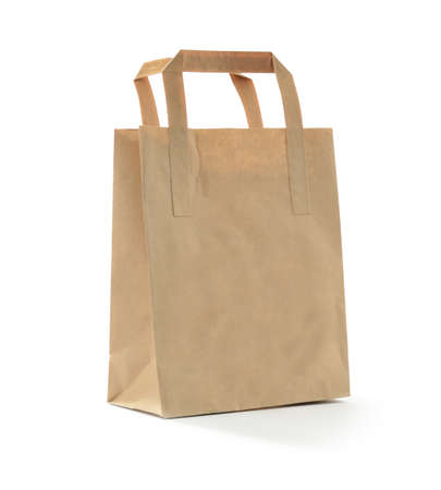 Studio photograph of a small brown bag against a white background with soft shadows  Copy space  photo