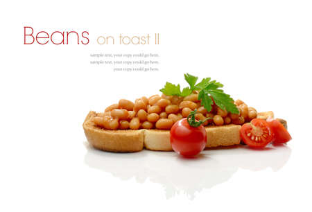 Studio macro of tasty baked beans on toast with garnish against a white background with soft shadows. Copy space.