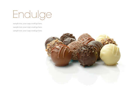 Studio macro of assorted delicious liqueur chocolates on a white background with soft shadows Standard-Bild