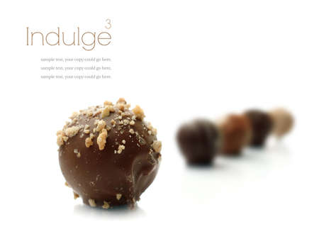 praline: Studio macro of assorted delicious liqueur chocolates on a white background with soft shadows Stock Photo