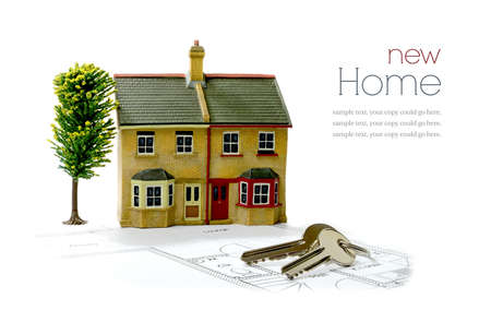 Concept image for new home with floor plans and shiny house keys on a white background. Copy space. Standard-Bild