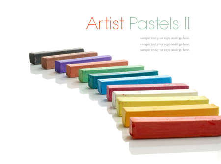 Studio macro of a selection of colorful artists pastels on a white background with soft shadows. Copy space. photo
