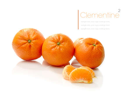 Studio macro of juicy clementines with soft shadows on a white surface. Stock Photo - 18166566