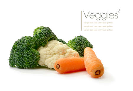broccolli: Studio macro of brocolli, cauliflower and carrots with soft shadows on a white surface. Copy space. Stock Photo