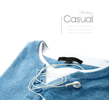 Concept image for youths and students. Studio close up of non-branded casual clothes and MP3 buds. photo