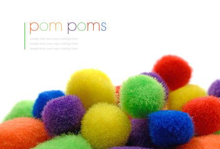 pom pom: Studio macro of colorful fluffy pom poms against a white background. Copy space.