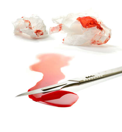 negligence: Concept stock image for clinical negligence or clinical malpractice. Surgical steel scalpel, pool of blood and blood stained tissues against white background. Copy space. Stock Photo
