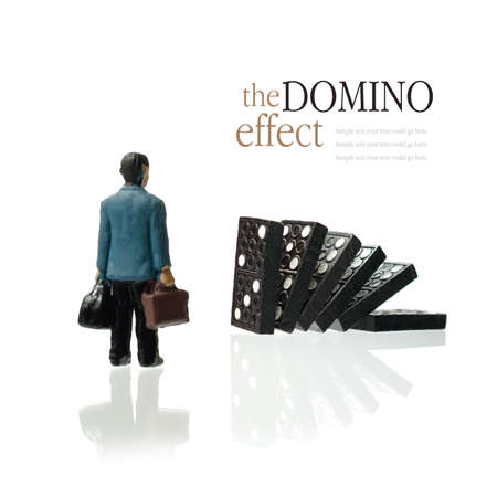 daunting: Concept image depicting the domino effect in business for example unemployment or retirement  Copy space