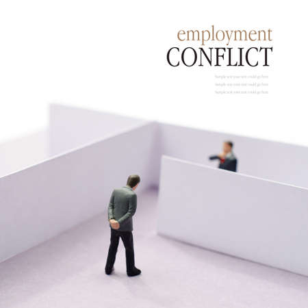 divided: Concept image depicting a situation of employment conflict or tension in the work place. Copy space. Stock Photo