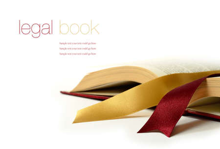 Stock photograph of legal concept, old book with legal ribbon ties on a white surface. Copy space. Standard-Bild