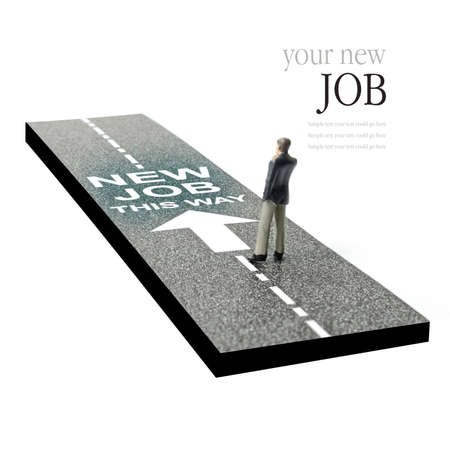 Concept image depicting a business man on the road to a new job. Selective focus on the road text. Copy space.
