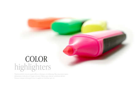 office tool: Studio macro of colorful highlighters against a white background. Copy space.