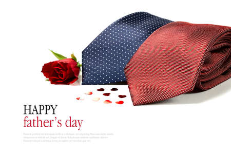 neck tie: Happy Fathers Day concept image with two smart generic business mans ties folded with hearts and a red rose against a white background. Copy space.