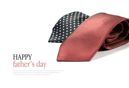 neck tie: Happy Fathers Day concept image with two smart generic business mans ties folded against a white background. Copy space. Stock Photo