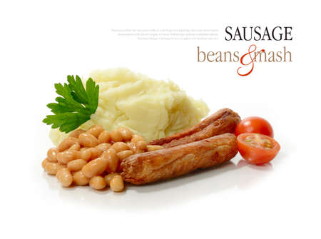 baked potato: Studio macro of sausage, beans and mash with parsley garnish against a white background. Copy space.