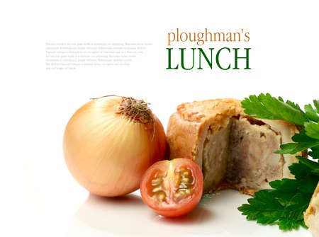 british food: Macro of English Ploughmans lunch, pork pie, onion and tomato against a white background. Copy space. Stock Photo