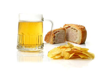 Concept image of a poor English diet enjoyed by many! Beer, potato chips and pork pie. Health care issues surrounding  obesity, heart disease and stroke. Copy space.  photo