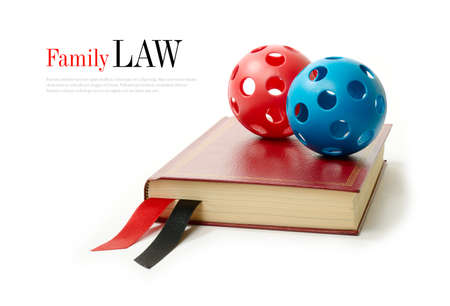 law library: Law concept stock image. Silk ribbons on a legal book against a white background. Copy space. Stock Photo