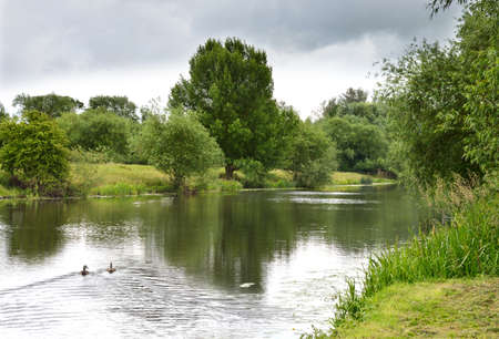 river bank: Scenic view of the beautiful, peaceful River Soar as it approaches its mouth  where it joins the River Trent in Nottinghamshire.
