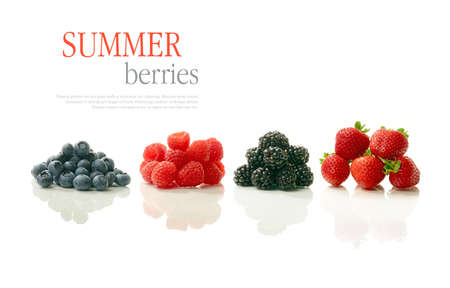 A studio image of fresh, ripe summer berries. Blueberries, raspberries, blackberries and strawberries all with soft reflections against a white background. Photographed to precise collective scale. Copy space.