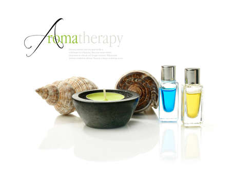 Concept image depicting aromatherapy treatments with medication bottles and seashells on a clinically clean white surface  Copy space  photo