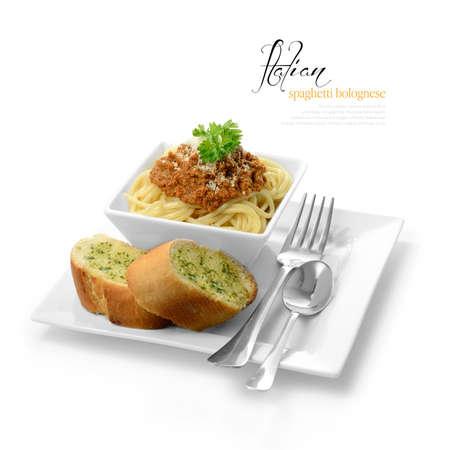 High key studio shot of freshly prepared Italian Spaghetti Bolognese with garlic bread  Selectively lit to create soft shadows  Copy space  版權商用圖片