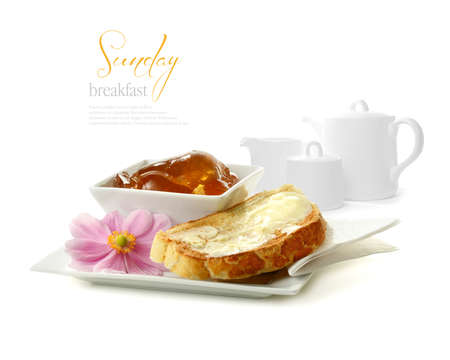 jam sandwich: Montage image of fresh white toast, breakfast marmalade and tea service against a white background  Perfect for your hotel brochure, breakfast menu or Mother