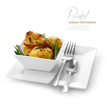 wedge: Studio image of fresh seasoned roasted potatoes with black pepper, garlic and rosemary against a white background  A perfect image for your restaurant showing attention to detail  Copy space