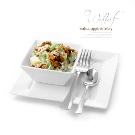 appetizers menu: Studio image of fresh Waldorf Salad with black pepper, walnuts, apple and celery against a white background  A perfect image for your restaurant showing attention to detail  Copy space