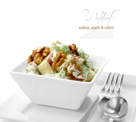 salad dressing: Studio macro of fresh Waldorf Salad with black pepper, walnuts, apple and celery against a white background  A perfect image for your restaurant showing attention to detail  Copy space