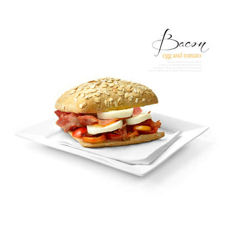 Juicy, appetizing egg and bacon roll with sliced tomato against a white background with soft shadows. The perfect lunch. Copy space. photo