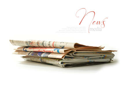 A stack of fresh newspapers with soft shadows against a white background  Copy space